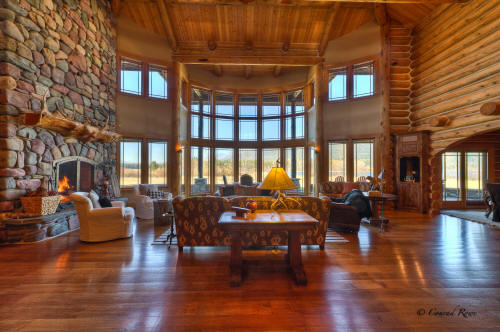 This amazing 7,500 sq. ft. custom-built log home boasts five bedrooms, six bathrooms and includes a gourmet kitchen
